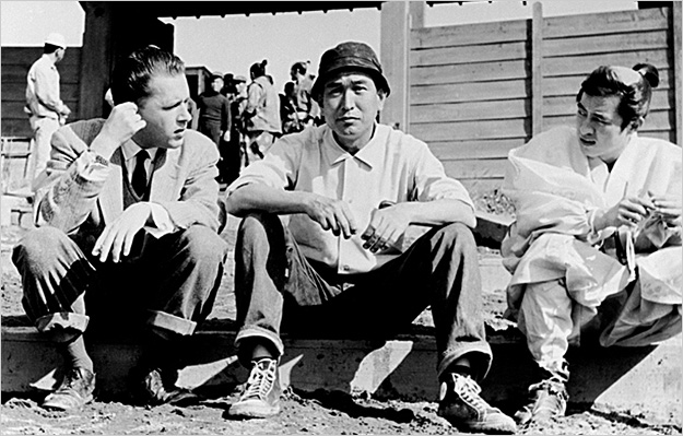 Donald Richie (left) with Akira Kurosawa (center)